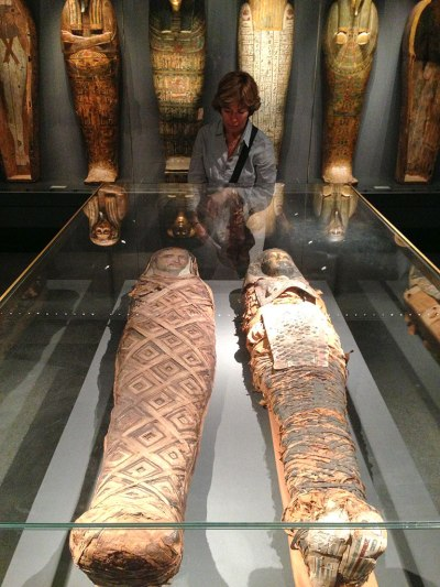 Mummies on row and one behind.